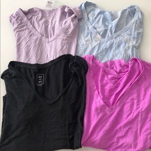 (4) V-Neck t shirts , 3 from American Eagle